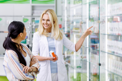 pharmacist happily assisting a customer